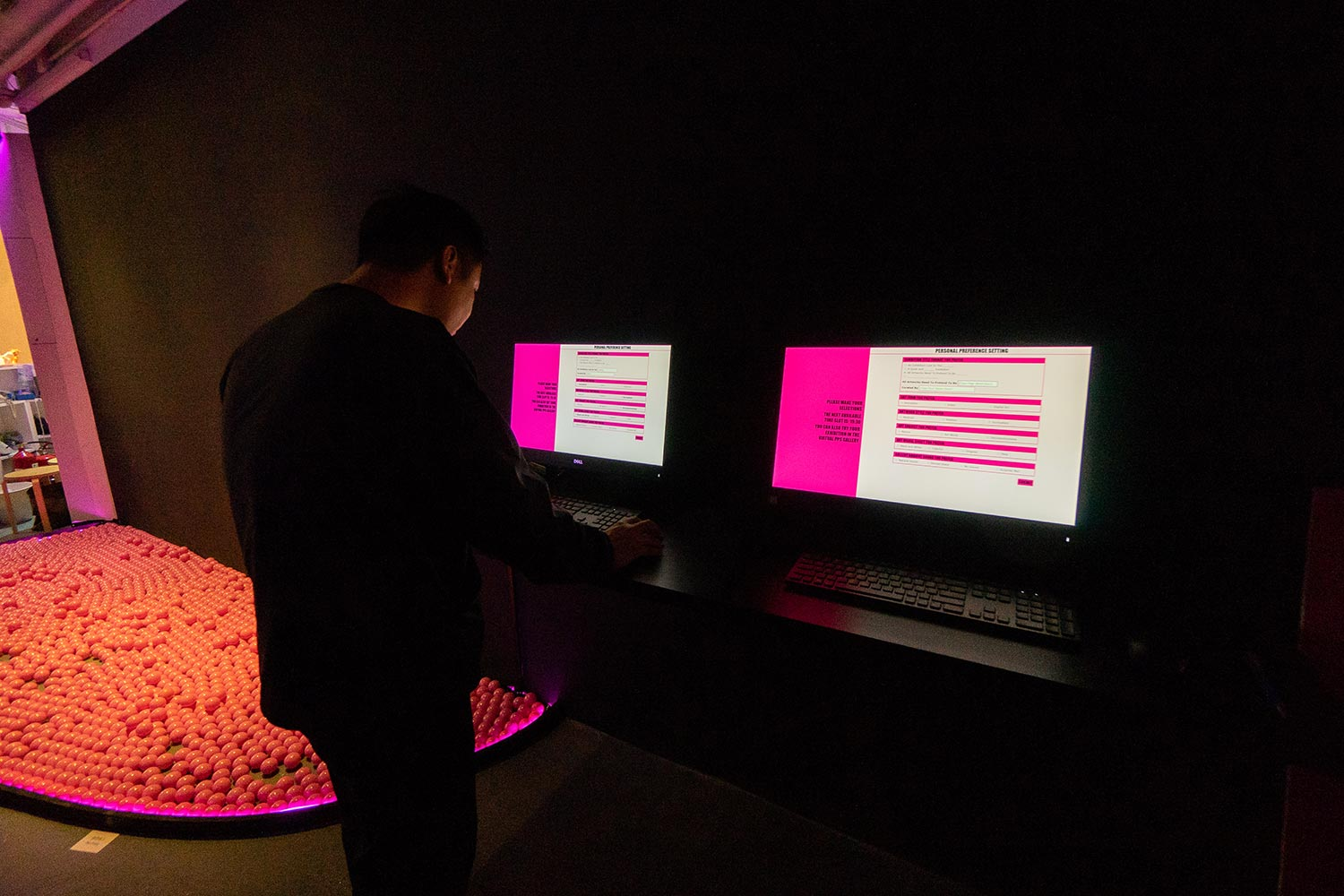 K11 visitor creating a custom exhibition using on-screen forms